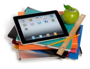 Various tools of the student: notebooks, ruler, tablet, and notebook computer.