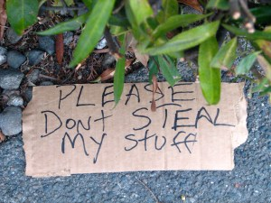 "Sign reading ""Please Dont Steal My Stuff"""