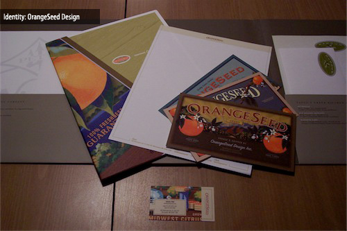 A design brief pocket folder, letterhead, 3 postcards and a business card.