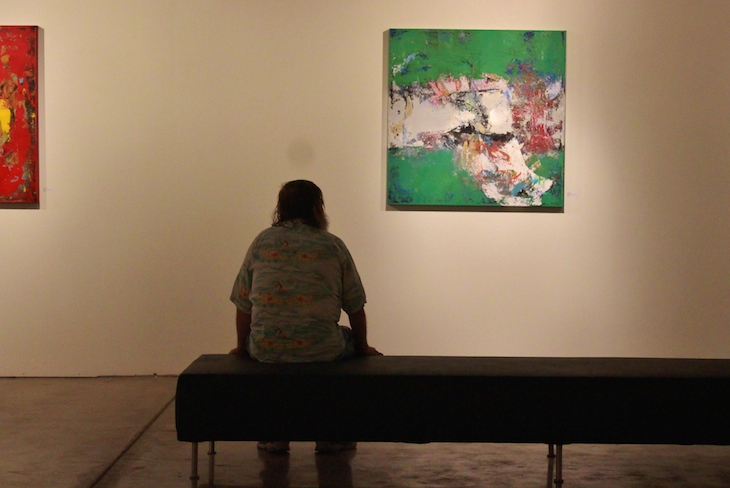 art gallery bench green painting