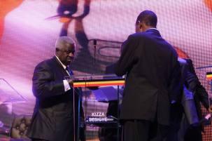 FDC's Chairperson; Ambassador Waswa Birigwa talking Dr. Kizza Besigye during the debate break. Photo by Ronnie Mayanja