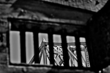 Bridge through Bars