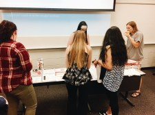 NAMI UGA organization members gather around pizza and mental health resources after the second general body meeting