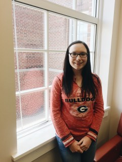 Ashley Reed, co-PR chair at NAMI UGA posed for a picture as she shared blog details at the Miller Learning Center