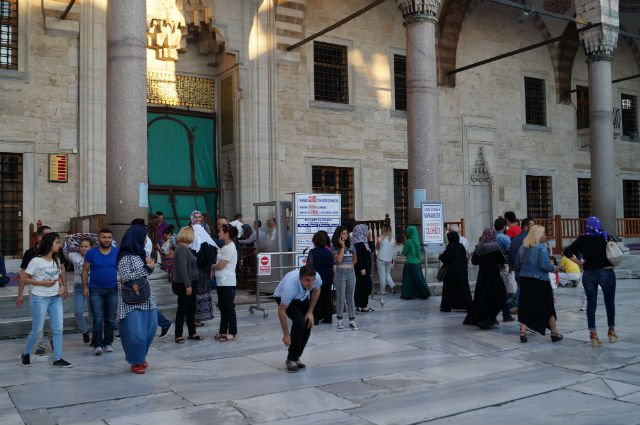 My Tips for Istanbul Turkey - Locals coming out of a Mosque