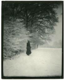 Charlotte Shaw in full Edwardian elegance on a snowy walk around the village.