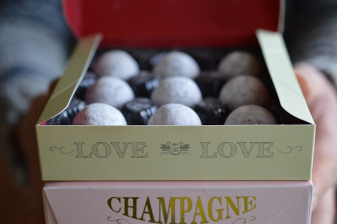 Open box of chocolate truffles with Love written on the box / Beech's chocolate truffles / SHE-EATS