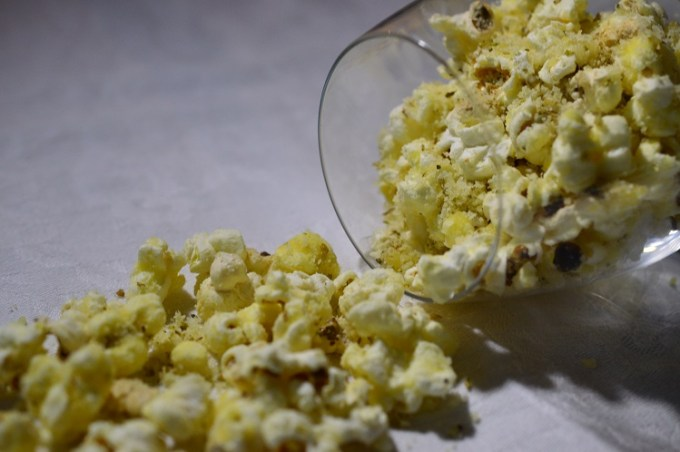 Popcorn tumbling from a glass