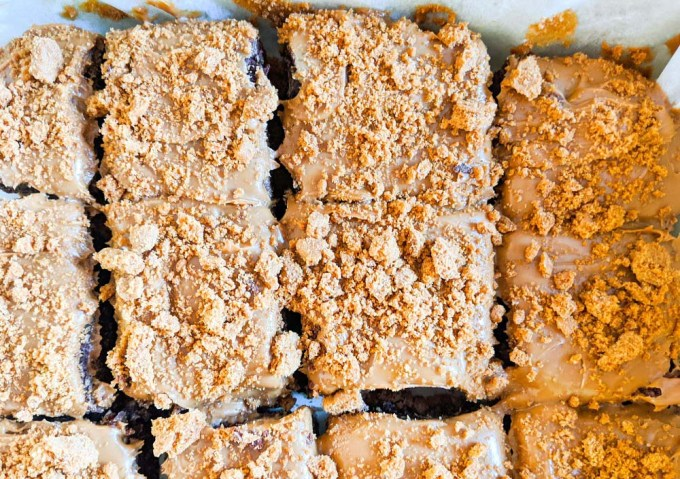 Tray of brownies with biscoff spread and crumbs on top