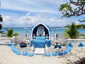 Marshall Islands Likieps chapell at the beach with the view to our sailboat in the lagoon