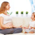 mom and baby doing diastasis recti breathing exercises
