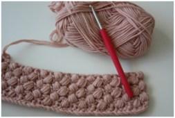 Pink crocheted bonnet
