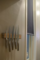 Magnetic knife holder above the peninsula counter.