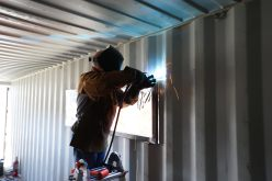 Putting windows into the shipping container office project.