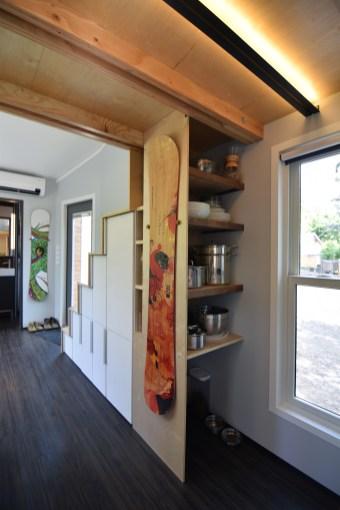 Kitchen storage behind the stairs