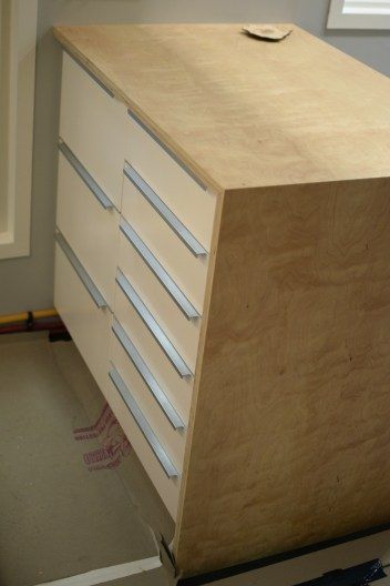 "1"" birch plywood wrapped peninsula counter + storage"
