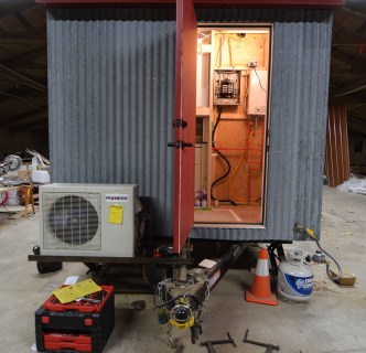 Mounted Mini-split Condenser, Propane hook up, and electrical/plumbing progress on the interior