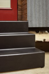 """Exterior stairs folded out of a piece of 1/4"""" hot rolled blackened steel plate."""