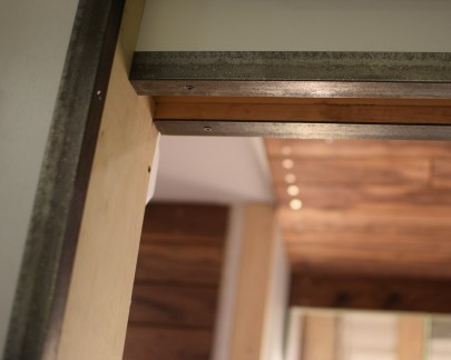 pocket door opening trimmed out in steel angle