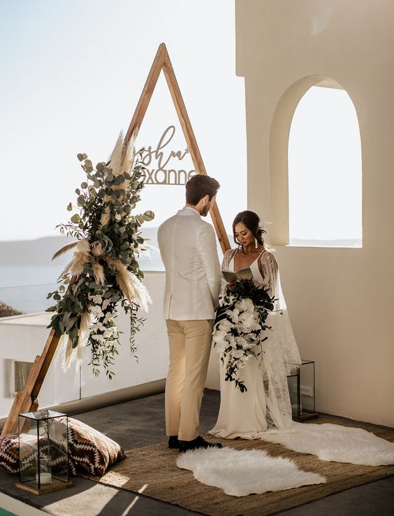 https://greenweddingshoes.com/edgy-meets-modern-elopement-on-santorini/