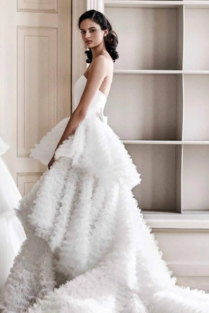 Clean, structural lines meet dramatic floral details, the Spring/Summer 2021 Viktor&Rolf Mariage bridal collection offers stunning looks for non-lace wedding dress lovers.