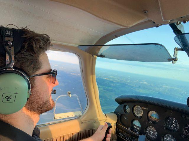 Zach Shefska flying an airplane