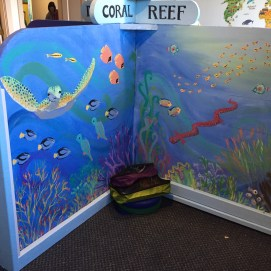Curious World Exhibit, Coral Reef Biome mural discovery area. Curious City Pop-Up Children's Museum, Peabody, MA