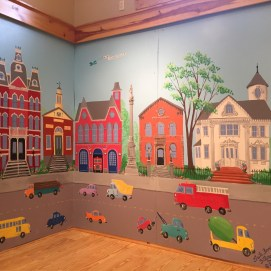 Main Street Exhibit mural at Curious City.
