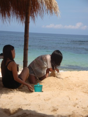 Playing like kids in the Sand- one of our trips in Bolinao Beach, Philippines