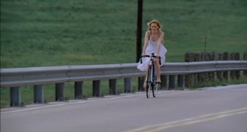Dawn cycling away from her house and family