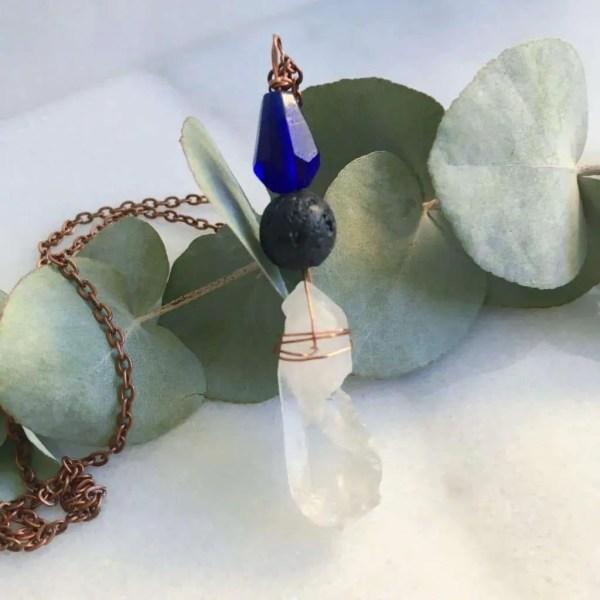 Quartz crystal essential oil diffuser necklace on copper chain