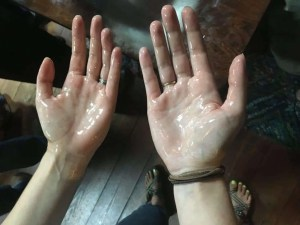hands covered in oil