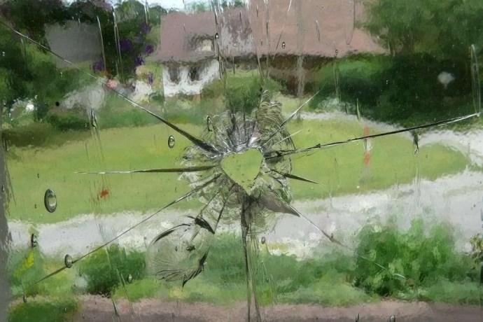 heart shaped hole in broken glass