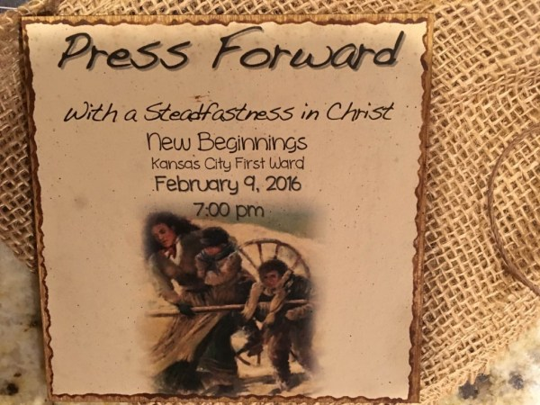 Invitation New Beginnings Press Forward done on a slab of wood, sent in burlap sack