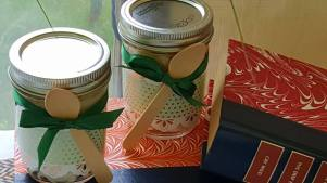 Cupackes in a jar for, dressed for a wedding.
