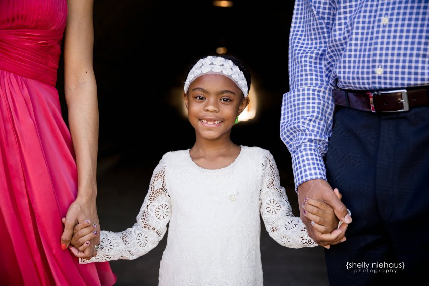 Daughter holding mom and dad hand - Mckinney family photography