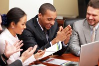 Multi ethnic business team at a meeting. Interacting. Focus on a
