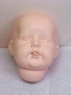 Celluloid Doll Face After