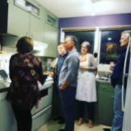 Friends gathering in the kitchen for a 'Mexican' experience.