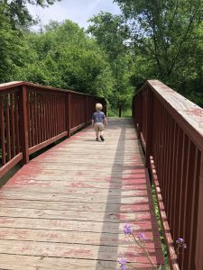 Toddler running down bridge