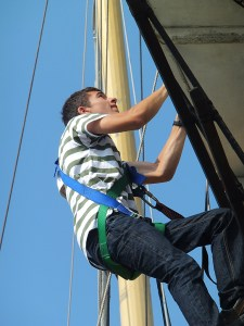 Tully climbs the rigging of TS Pelican on Youth Sail Away project
