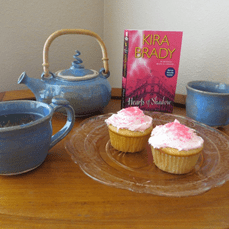 Dragon Pearl Tea with pink cupcakes.