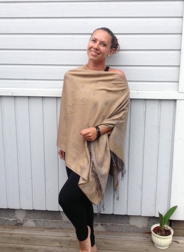 Oversized poncho in golden sand