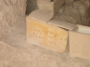 Ossuaries (bone boxes) inside a tomb in Israel.