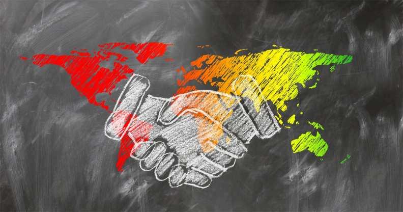 shaking hands world map