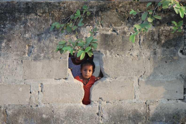 neighbor child looking through wall