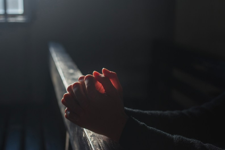 praying hands in church