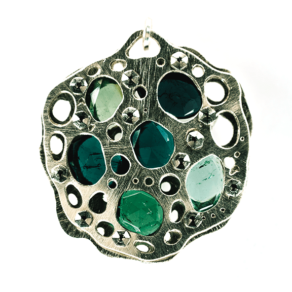 Rose cut blue and green tourmalines tension set in recycled sterling silver in this necklace created by Sherry Cordova Jewelry