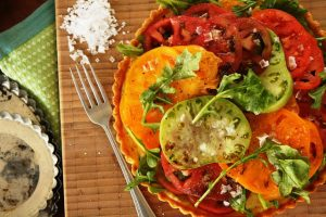 black pepper cornmeal tarts with heirloom tomato salad