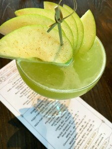 Apple Martini with whiskey, fresh Granny Smith apple juice, bruleed apple bitters | ShesCookin.com